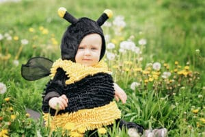 baby in bee costume during spring